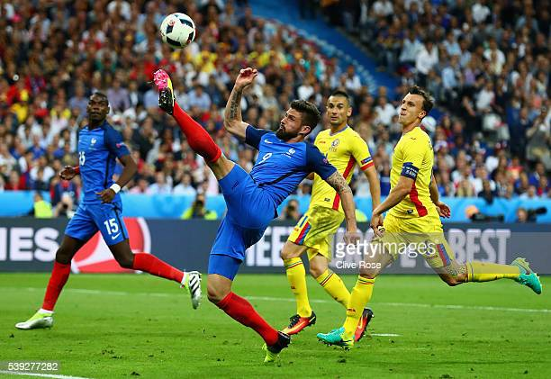 Olivier Giroud of France controls the ball during the UEFA Euro 2016 Group A match between France and Romania at Stade de France on June 10, 2016 in...
