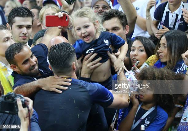 Olivier Giroud of France gets his daughter Jade Giroud from his wife Jennifer Giroud following the 2018 FIFA World Cup Russia Final between France...