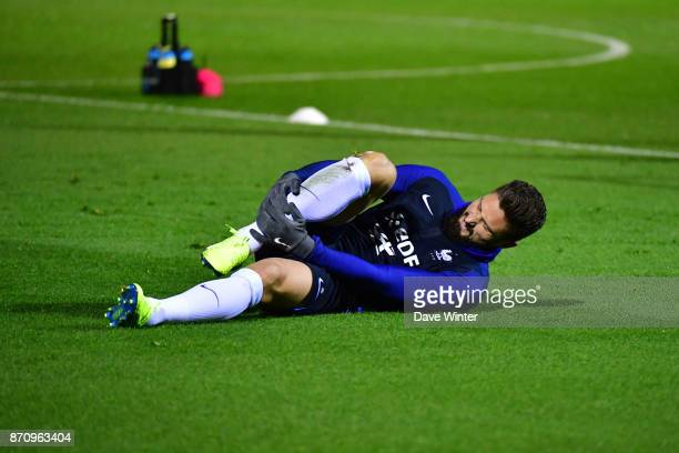 Olivier Giroud of France goes down injured during the training session at the Centre National de Football in Clairefontaine en Yvelines France on...