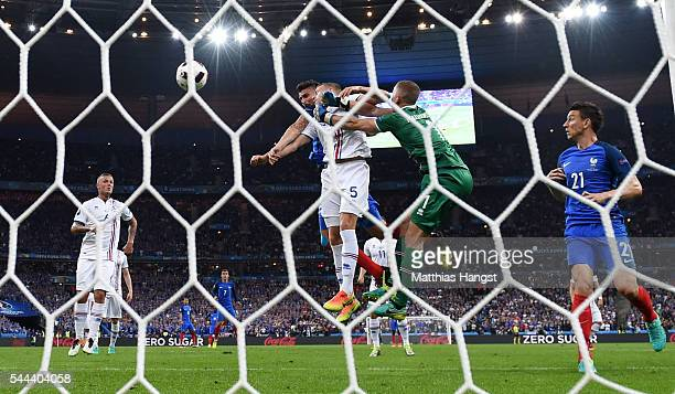 Olivier Giroud of France heads the ball to score his team's fifth goal during the UEFA EURO 2016 quarter final match between France and Iceland at...