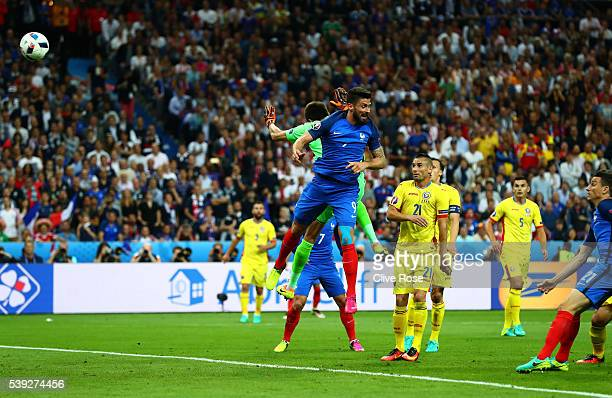Olivier Giroud of France heads the ball to score his team's first goal during the UEFA Euro 2016 Group A match between France and Romania at Stade de...