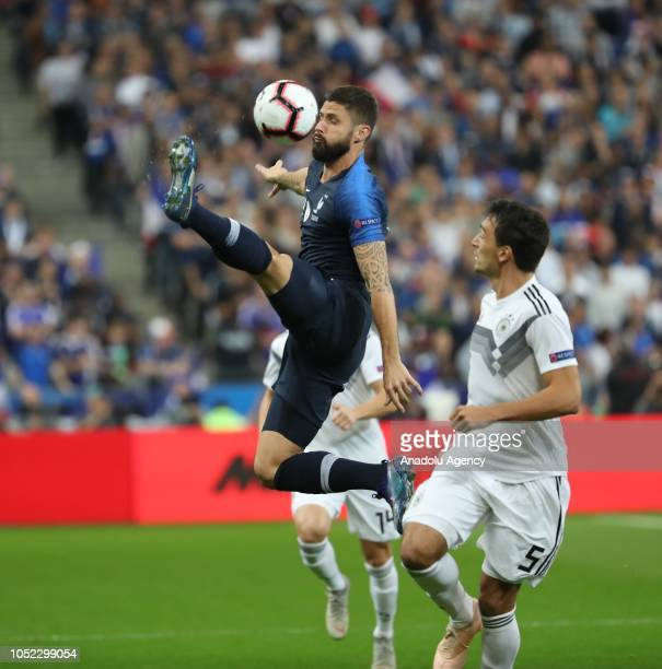 Olivier Giroud of France in action against Hummels of Germany during the UEFA Nations League A Group 1 match between France and Germany at Stade de...