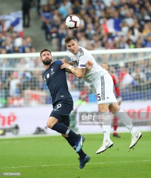 Olivier Giroud of France in action against Mats Hummels of Germany during the UEFA Nations League A Group 1 match between France and Germany at Stade...