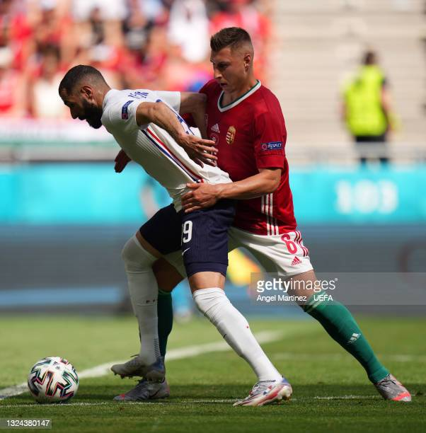 Olivier Giroud of France is challenged by Willi Orban of Hungary during the UEFA Euro 2020 Championship Group F match between Hungary and France at...