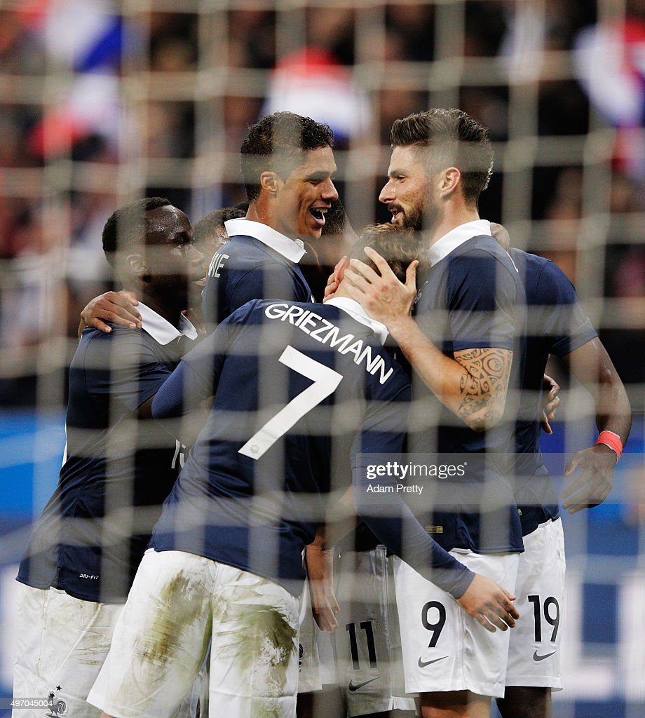 Olivier Giroud of France is congratulated after scroing the first goal during the International Friendly match between France and Germany at the Stade de France on November 13, 2015 in Paris, France.