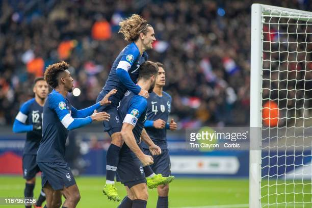 Olivier Giroud of France is congratulated by Antoine Griezmann of France after scoring from the penalty spot for his sides second goal during the...