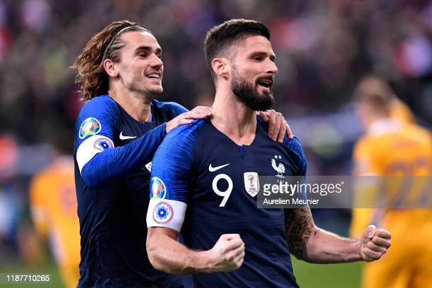 Olivier Giroud of France is congratulated by teammate Antoine Griezmann after scoring during the UEFA Euro 2020 Qualifier between France and Moldova...