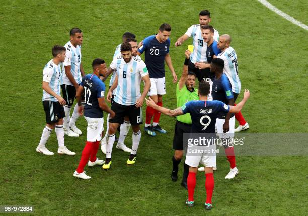 Olivier Giroud of France is shown a yellow card by referee Alireza Faghani during the 2018 FIFA World Cup Russia Round of 16 match between France and...