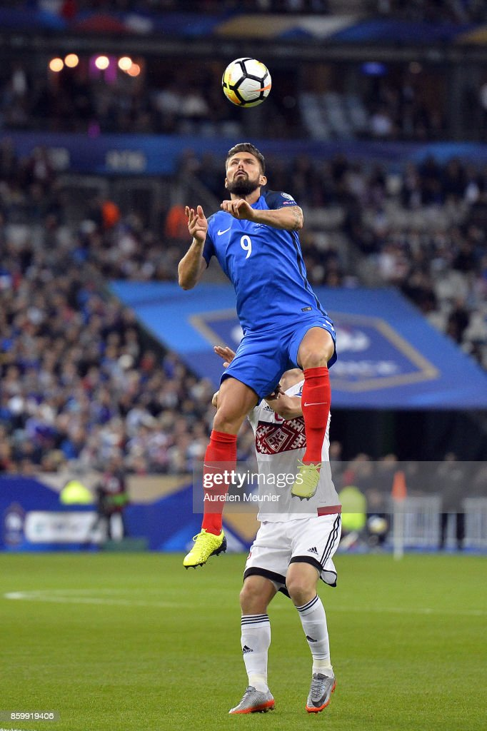 Olivier Giroud of France jumps for the ball during the FIFA 2018 World Cup Qualifier between France and Belarus at Stade de France on October 10, 2017 in Paris.