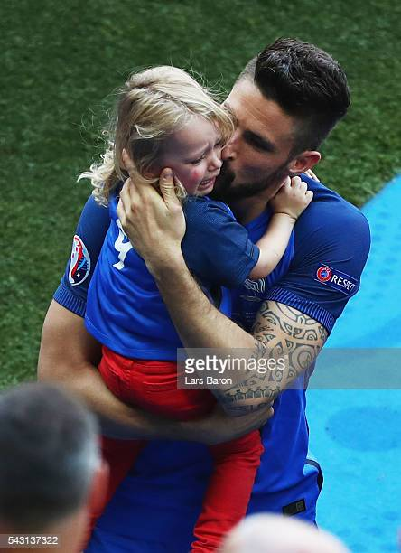 Olivier Giroud of France kisses his daughter Jade to celebrate his team's 2-1 win after the UEFA EURO 2016 round of 16 match between France and...