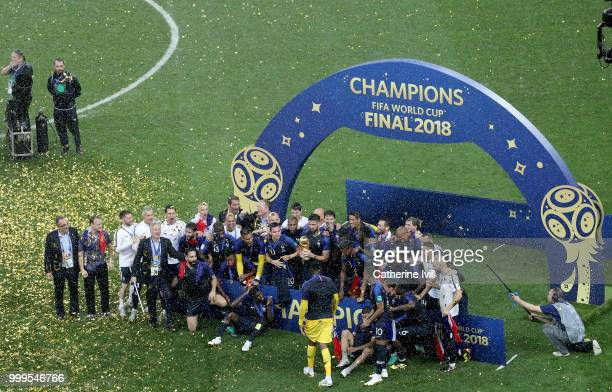 Olivier Giroud of France lifts the World Cup trophy to celebrate with teammates and staff after during the 2018 FIFA World Cup Final between France...