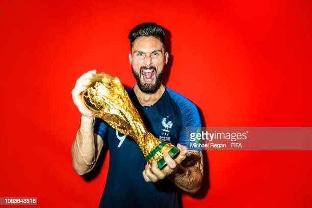 Olivier Giroud of France poses with the Champions World Cup trophy after the 2018 FIFA World Cup Russia Final between France and Croatia at Luzhniki...