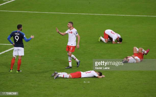 Olivier Giroud of France react with Merih Demiral of Turkey after the 2020 UEFA European Championships Group H qualifying match between France and...