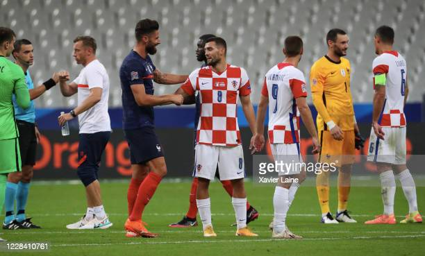 Olivier Giroud of France reacts with Mateo Kovacic of Croatia after the UEFA Nations League group stage match between France and Croatia at Stade de...