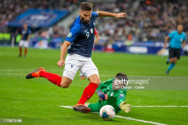 September 10: Olivier Giroud of France rounds goalkeeper Josep Gómes of Andorra but shoots wide from a tight angle during the France V Andorra, UEFA...