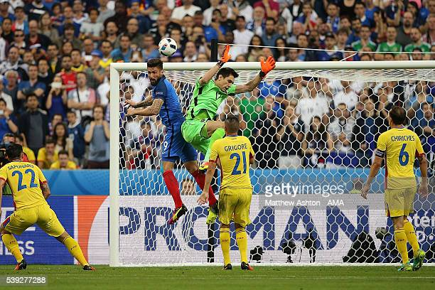 Olivier Giroud of France scores a goal to make the score 1-0 during the UEFA EURO 2016 Group A match between France and Romania at Stade de France on...