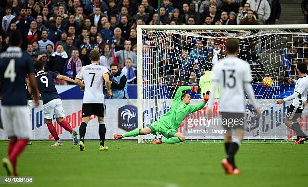 Olivier Giroud of France scores his side's opening goal past Manuel Neuer of Germany during the International Friendly match between France and...
