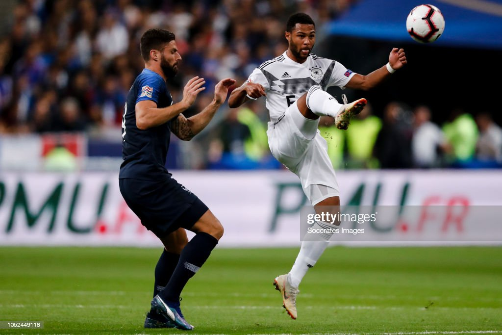 Olivier Giroud Of France Serge Gnabry Of Germany During The Uefa