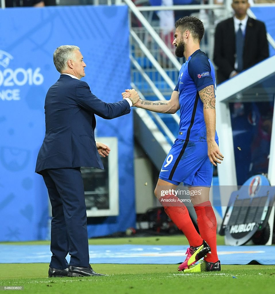 Olivier Giroud of France shakes hands with the head coach of France Didier Deschamps (L) during the Euro 2016 final match between Portugal and France at Stade de France in Paris, France on July 10, 2016.
