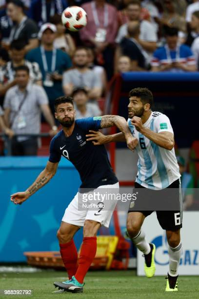 Olivier Giroud of France team vies Federico Fazio of Argentina during the 2018 FIFA World Cup Russia Round of 16 match between France and Argentina...