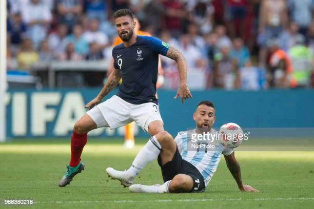 Olivier Giroud of France vies Nicolas Otamendi of Argentina during the 2018 FIFA World Cup Russia Round of 16 match between France and Argentina at...