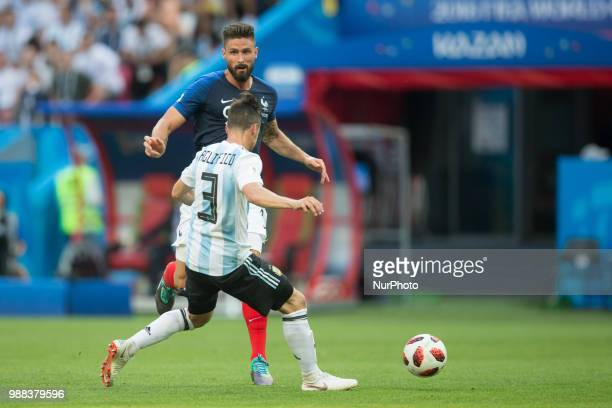 Olivier Giroud of France vies Nicolas Tagliafico of Argentina during the 2018 FIFA World Cup Russia Round of 16 match between France and Argentina at...