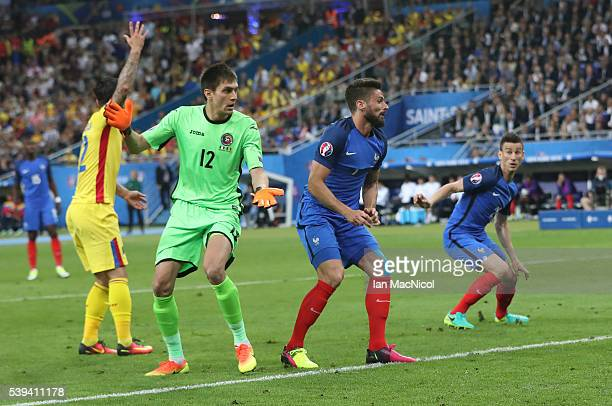 Olivier Giroud of France watches his header go into the net to open the scoring during the UEFA EURO 2016 Group A match between France and Romania at...