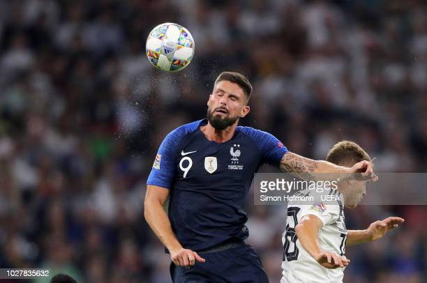 Olivier Giroud of France wins a header from Joshua Kimmich of Germany during the UEFA Nations League Group A match between Germany and France at...