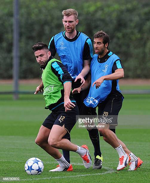 Olivier Giroud, Per Mertesacker and Mathieu Flamini of Arsenal during a training session at London Colney on September 15, 2015 in St Albans, England.