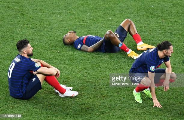 Olivier Giroud, Presnel Kimpembe and Adrien Rabiot of France look dejected after losing in the penalty shoot out in the UEFA Euro 2020 Championship...