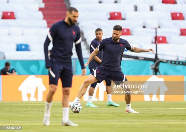Olivier Giroud R and Kylian Mbappe C of France attend a training session in Munich, Germany, June 14, 2021. France is to play against Germany in a...