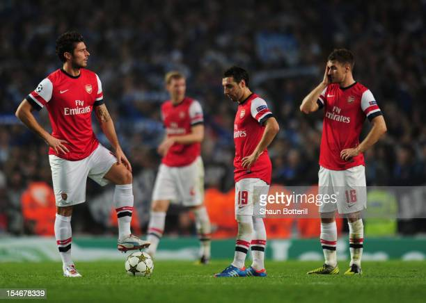 Olivier Giroud Santi Cazorla and Aaron Ramsey of Arsenal look dejected during the UEFA Champions League Group B match between Arsenal and FC Schalke...