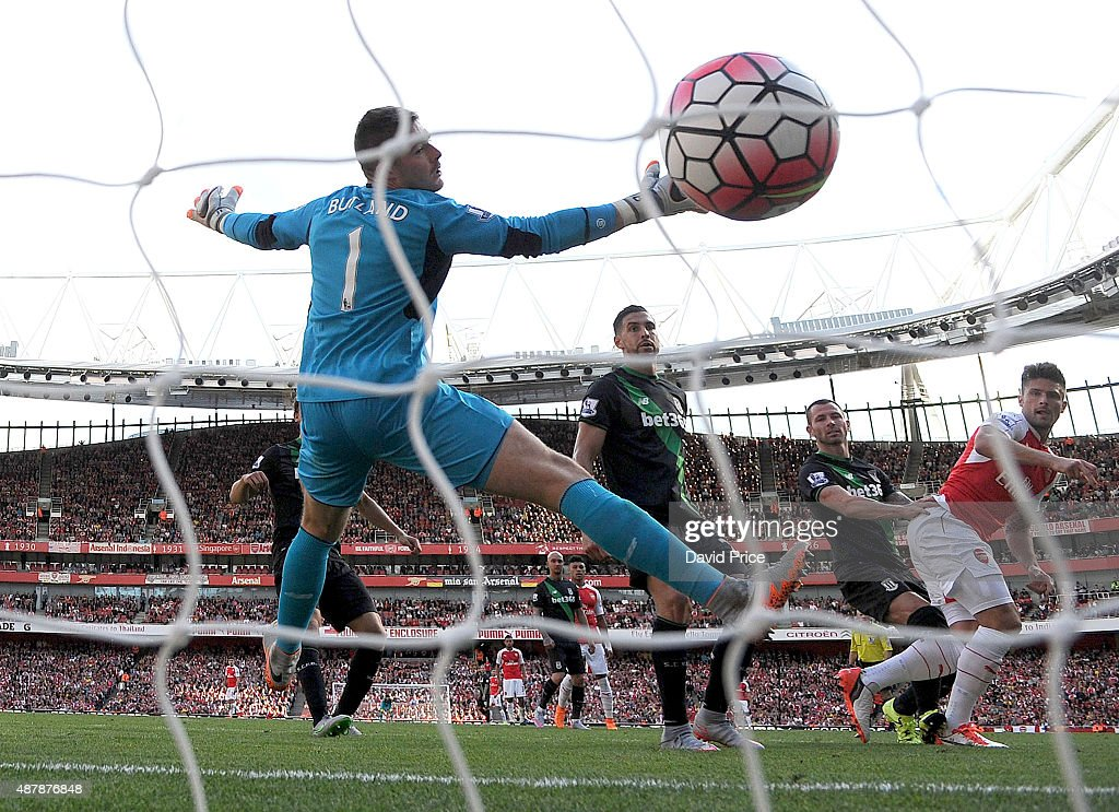 Olivier Giroud scores Arsenal's 2nd goal past Jack Butland of Stoke during the Barclays Premier League match between Arsenal and Stoke City on September 12, 2015 in London, United Kingdom.