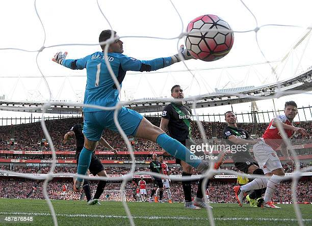 Olivier Giroud scores Arsenal's 2nd goal past Jack Butland of Stoke during the Barclays Premier League match between Arsenal and Stoke City on...