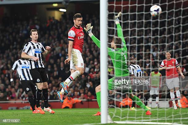Olivier Giroud scores Arsenal's 3rd goal past Tim Krul of Newcastle as Mike Williamson of Newcastle looks on during the match between Arsenal and...
