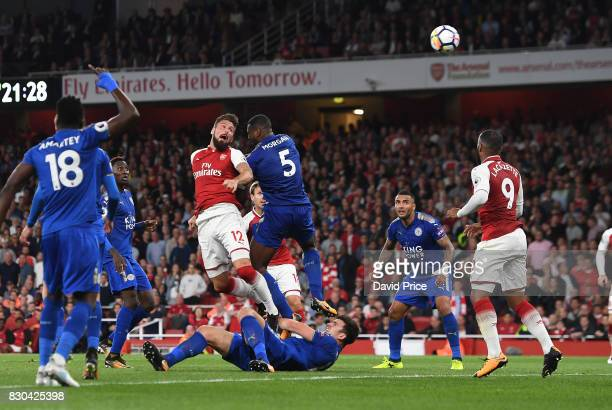 Olivier Giroud scores Arsenal's 4th goal under pressure from Wes Morgan of Leicester during the Premier League match between Arsenal and Leicester...