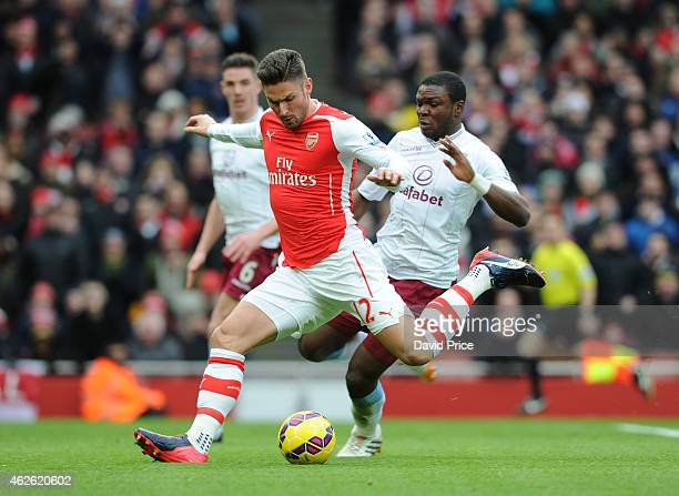 Olivier Giroud scores Arsenal's goal under pressure from Jores Okore of Villa during the match between Arsenal and Aston Villa in the Barclays...