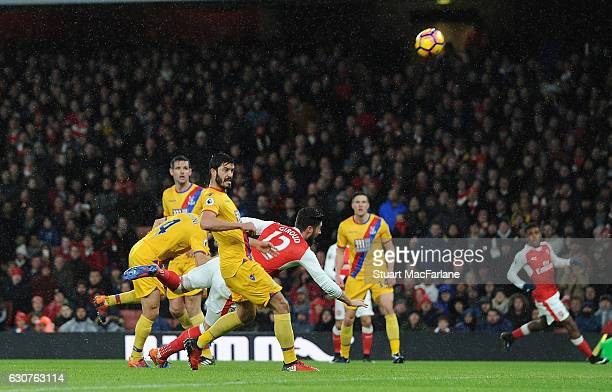 Olivier Giroud scores for Arsenal during the Premier League match between Arsenal and Crystal Palace at Emirates Stadium on January 1 2017 in London...