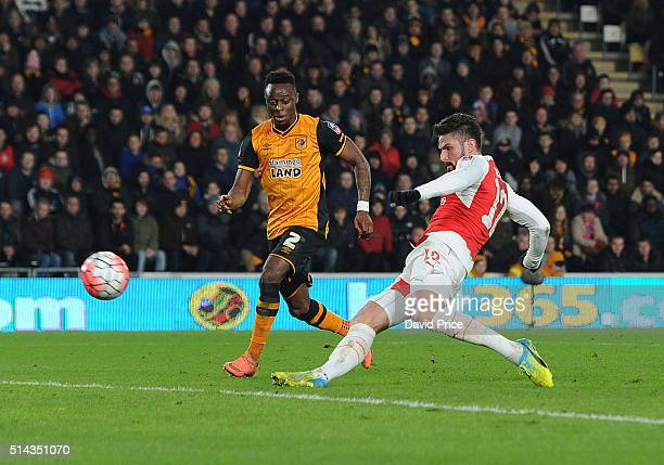 Olivier Giroud scores his and Arsenal's 2nd goal as Moses Odubajo of Hull looks on during the match between Hull City and Arsenal in the FA Cup 5th...