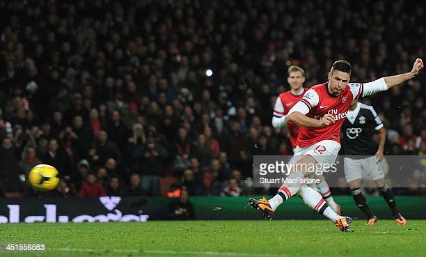 Olivier Giroud scores the 2nd Arsenal goal during the match at Emirates Stadium on November 23 2013 in London England