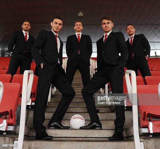 Olivier Giroud Thomas Vermaelen Per Mertesacker Aaron Ramsey and Lukas Podolski of Arsenal attend the Arsenal Foundation Charity Ball at Emirates...
