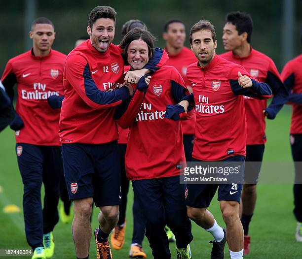 Olivier Giroud, Tomas Rosicky and Mathieu Flamini of Arsenal in action during the Arsenal Training Session at London Colney on November 9, 2013 in St...