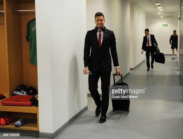 Olivier Giroud walks into the Arsenal changing room before the Barclays Premier League match between Arsenal and West Bromwich Albion at Emirates...