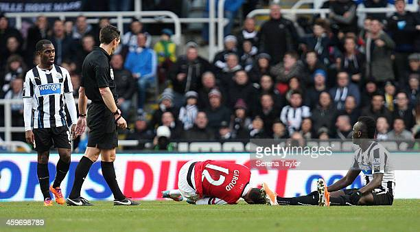 Olivier Giround of Arsenal goes to ground after challenging Newcastle United's Cheick Tiote during the Barclays Premier League match between...