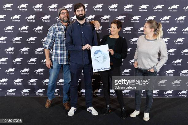 Olivier Gourmet Antoine Russbach Elodie Brunner and Delphine Bibet hold a photo of the Ukrainian filmmaker Oleg Gennadyevich Sentsov to support the...