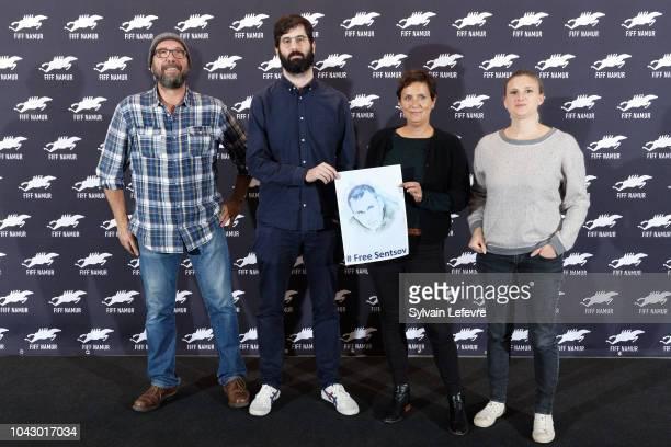 Olivier Gourmet Antoine Russbach Elodie Brunner and Delphine Bibet hold a photo of the Ukrainian filmmaker Oleg Gennadyevich Sentsov to support the...