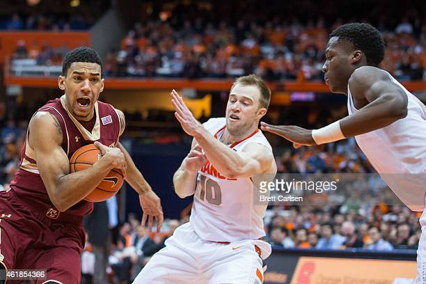 Olivier Hanlan of the Boston College Eagles drives to the basket as Trevor Cooney and Tyler Roberson of the Syracuse Orange defend on January 20 2015...