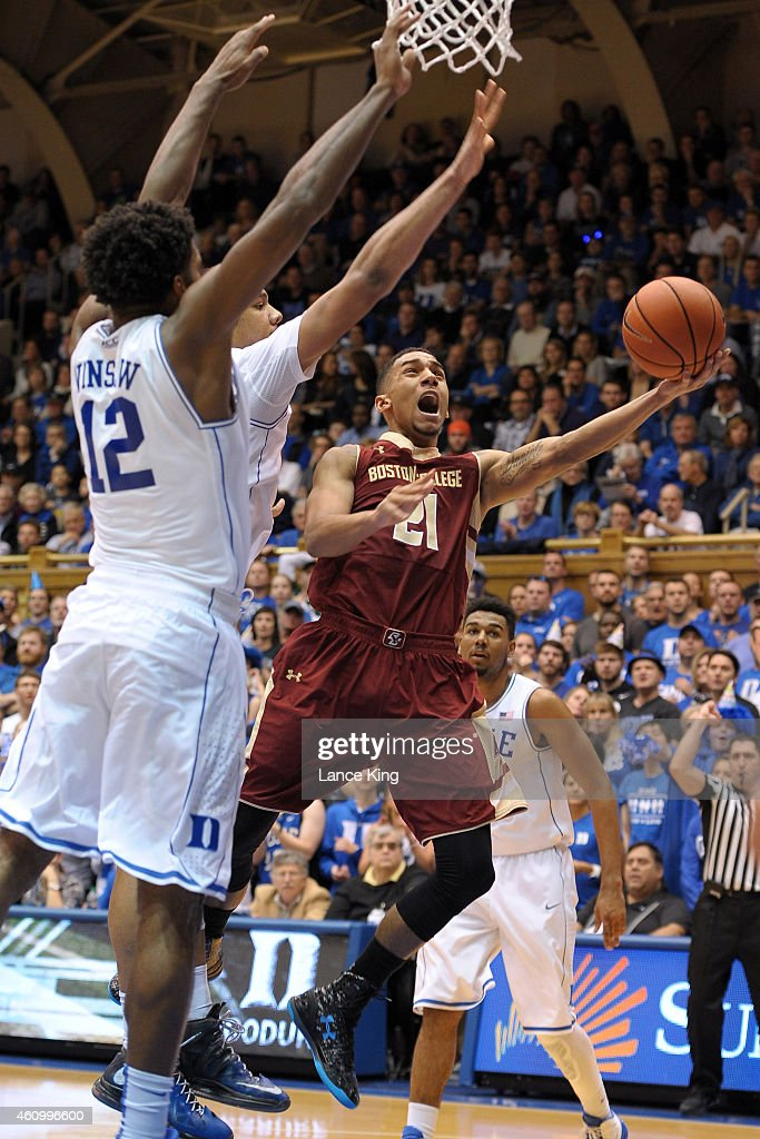 Olivier Hanlan #21 of the Boston College Eagles goes to the basket against Justise Winslow #12 and Jahlil Okafor #15 of the Duke Blue Devils during their game at Cameron Indoor Stadium on January 3, 2015 in Durham, North Carolina.
