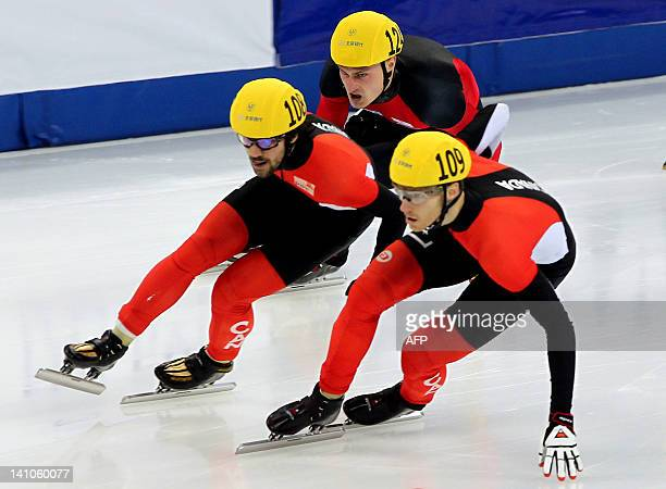 Olivier Jean of Canada leads the pack in the men 500meter final of ISU World Short Track Speed Skating Championships at the Oriental Sports Center in...