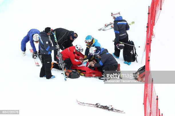 Olivier Jenot of Monaco receives medical attention after crashing out during the Men's Super G during the FIS Alpine World Ski Championships on...